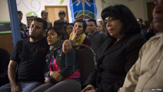 Undocumented immigrants and supporters watch Obama speak on immigration in Philadelphia