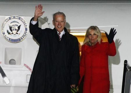 U.S. Vice President Joe Biden (L) and his wife Jill wave upon their arrival at Boryspil International …