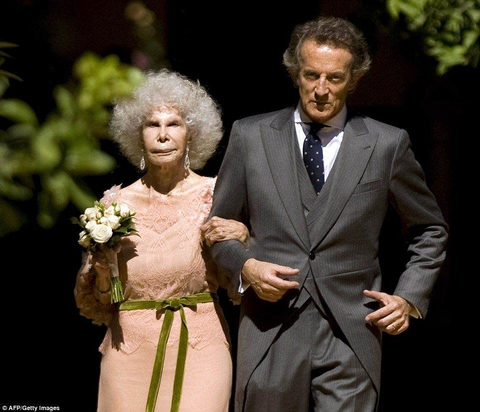 The Duchess and Alfonso Diez walk out of the chapel after their wedding in October 2011. It was the Spanish billionaire's third wedding  Read more: http://www.dailymail.co.uk/news/article-2842130/Spains-Duchess-Alba-Europes-richest-aristocrats-dies.html#ixzz3JhioumB0  Follow us: @MailOnline on Twitter | DailyMail on Facebook