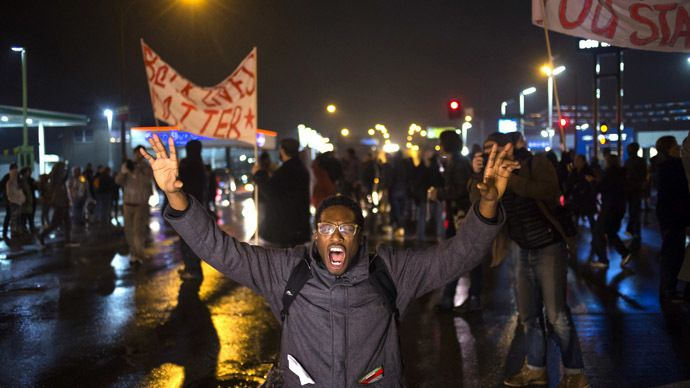 A protester, demanding the criminal indictment of a white police officer who shot dead an unarmed black teenager in August, shouts slogans while stopping traffic while marching through a suburb in St. Louis, Missouri November 23, 2014. (Reuters)