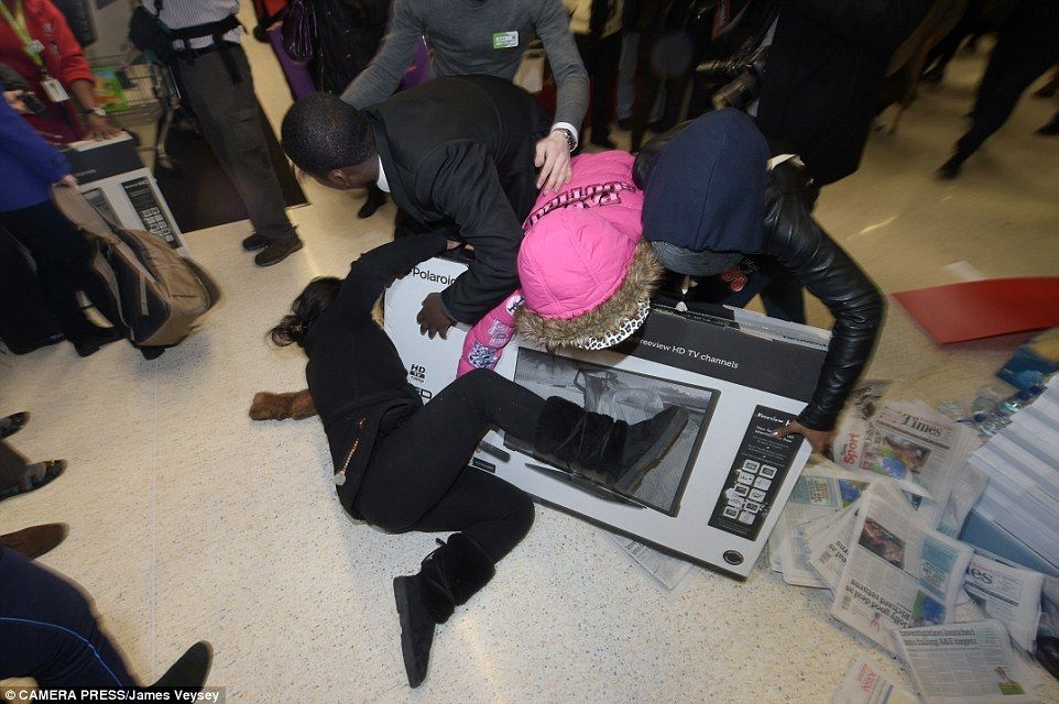 The shoppers were seen pushing and fighting one another on the shop floor as they tried to get their hands on the reduced item