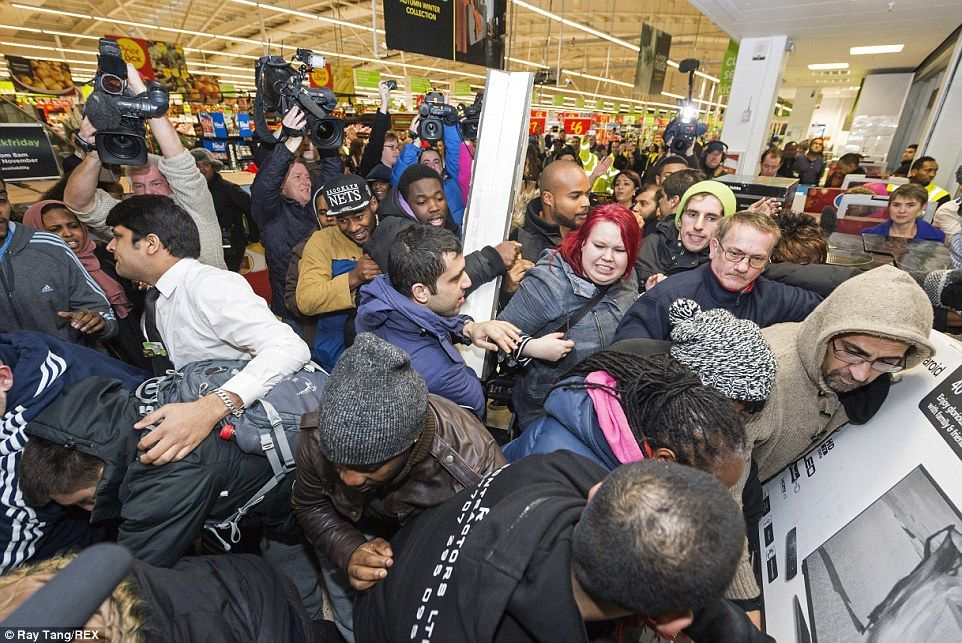 Shoppers scramble to get their hands on televisions, cooking appliances and other goods at Asda in Wembley, north London, this morning   Read more: http://www.dailymail.co.uk/news/article-2852585/Mayhem-Black-Friday-begins-Shoppers-clash-supermarkets-trying-grab-bargains-Boots-Game-Curry-s-PC-world-websites-crash-thousands-start-hunt-Christmas-deals.html#ixzz3KMg8bAhC  Follow us: @MailOnline on Twitter | DailyMail on Facebook