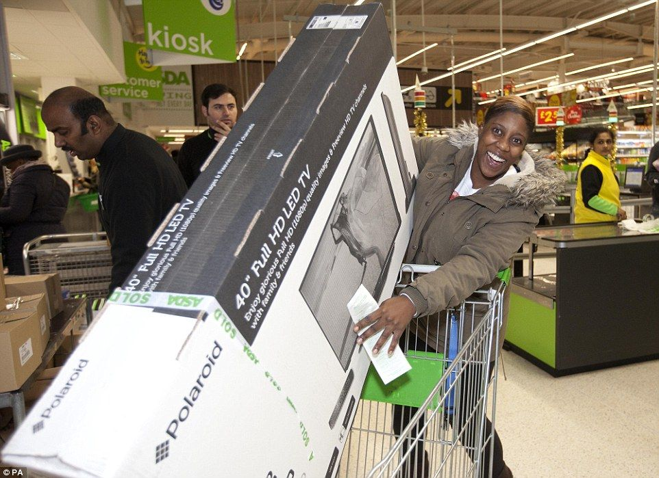 Cherrelle Welch in north London with her 40in HD Polaroid television being sold by the supermarket for just £139 - £90 less than usual  Read more: http://www.dailymail.co.uk/news/article-2852585/Mayhem-Black-Friday-begins-Shoppers-clash-supermarkets-trying-grab-bargains-Boots-Game-Curry-s-PC-world-websites-crash-thousands-start-hunt-Christmas-deals.html#ixzz3KMhCGJWb  Follow us: @MailOnline on Twitter | DailyMail on Facebook