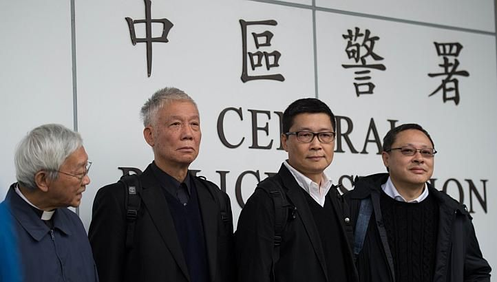 Benny Tai (right), an original founder of the pro-democracy Occupy movement,  with (from left) Chinese Cardinal of the Catholic Church and former bishop of Hong Kong, Joseph Zen, and Occupy Central co-leaders Chu Yiu-ming and Chan Kin-man surrender to police in Hong Kong on Dec 3, 2014.(Photo:AFP)