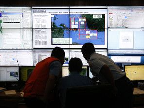 Authorities monitor progress in the search for AirAsia Flight QZ8501 in the Mission Control Center inside the National Search and Rescue Agency in Jakarta December 29, 2014. (Reuters)