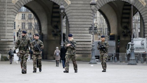 "French soldiers patrol near the Louvre Museum in Paris as part of the highest level of ""Vigipirate"" security plan January 8. (Reuters)"