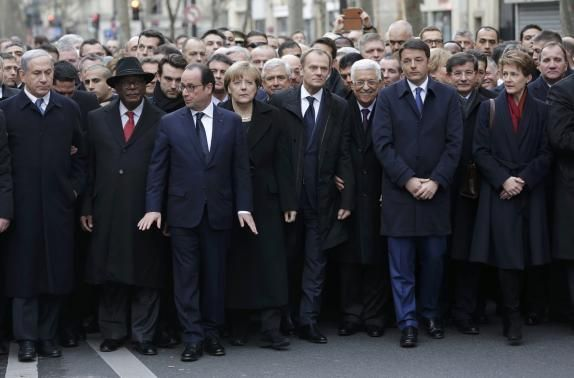 French President Francois Hollande is surrounded by head of states.