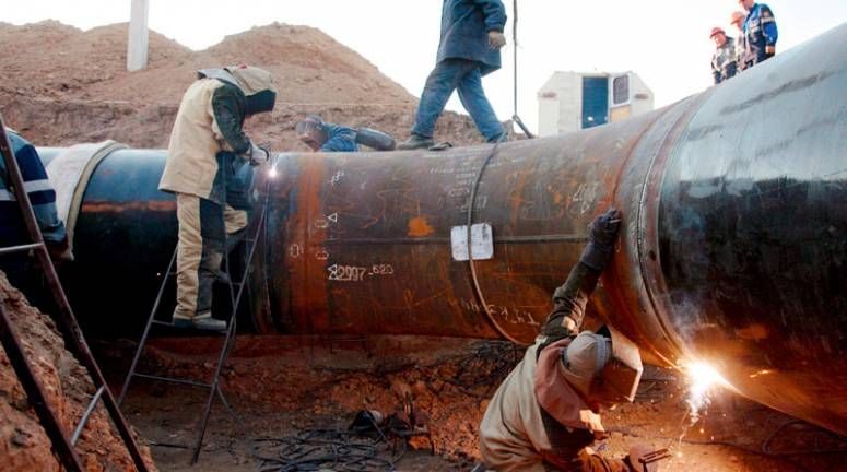 Welders construct a gas pipeline in Kazakhstan.