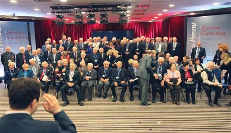 Holocaust survivors prepare for a group photo in Krakow, Poland, Monday, Jan. 26, 2015, a day before commemorations at the former Nazi death camp Auschwitz-Birkenau marking the 70th anniversary of the camp's liberation.