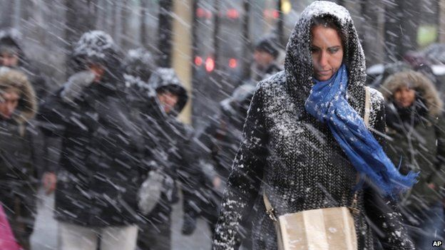 Pedestrians make their way through snow in New York This could be one of the biggest storms in New York City's history, meteorologists warn