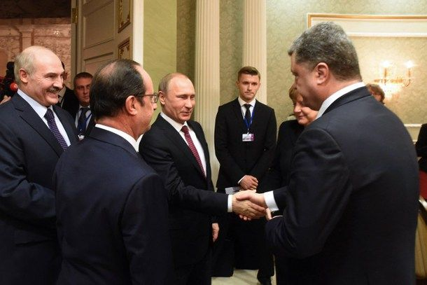 Russian President Vladimir Putin shakes hands with Ukrainian President Petro Poroshenko on Feb. 11 in Minsk. The leaders of Ukraine, Russia, France and Germany have agreed on a ceasefire deal.