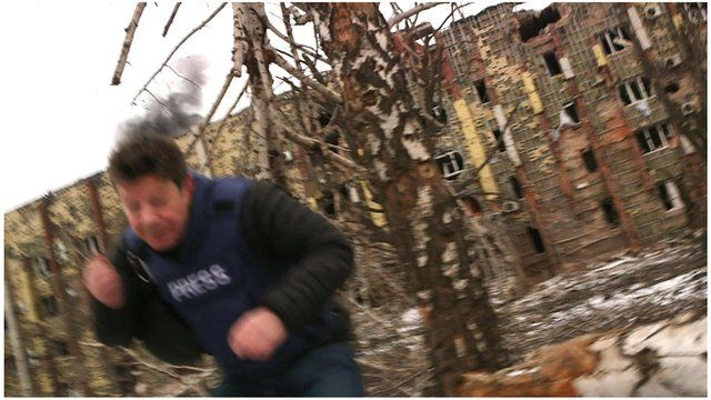 The BBC's Ian Pannell flees artillery fire at the ruins of Donetsk airport
