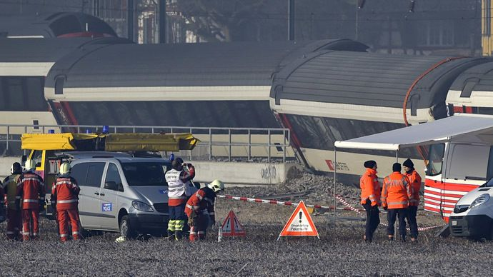 Rescue workers inspect the site of a train crash at the train station of Rafz, northern Switzerland, on February 20, 2015. (AFP)