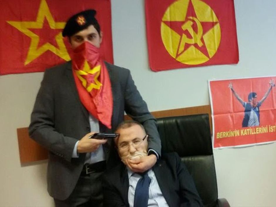 In this picture posted on the internet by the Turkish Marxist-Leninist left wing organization, the DHKP-C, shows an alleged millitant from the DHKP-C holding a gun to the head of prosecutor Mehmet Selim Kiraz in Istanbul on March 31, 2015.  Read more: http://news.nationalpost.com/news/world/prosecutor-killed-as-hostage-situation-ends-with-shootout-between-police-and-militants-at-istanbul-courthouse#ixzz3W2CFgjQL