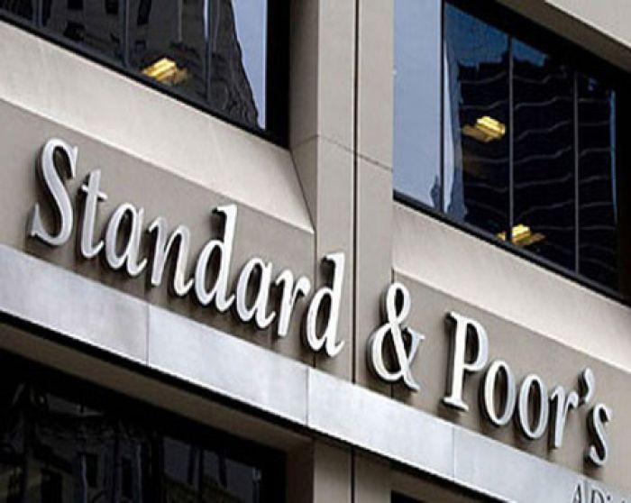 Kazkommertsbank to have difficulty in problem asset recovery without government support - S&P