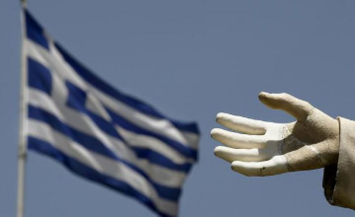 Greece offers tax hikes and pension reform in new bailout plan