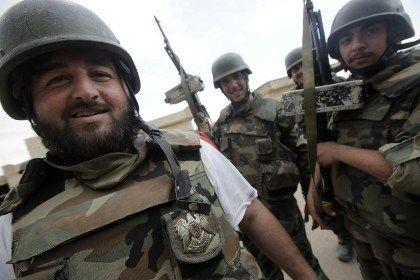 Сирия армиясының әскери қызметкерлері. Фото: Joseph Eid / AFP