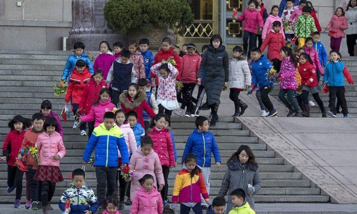Bloomberg: Қытай билігі бала санына қойылған шектеулерді алып тастамақ