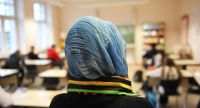 В мечети, школе и на улице