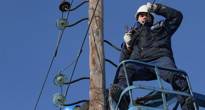 Из-за снегопада в Алматы произошло более 200 обрывов линий электропередачи